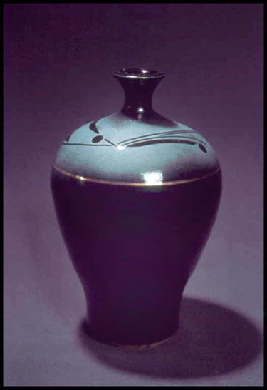 Bottle with grit-blasted design and gold luster glaze