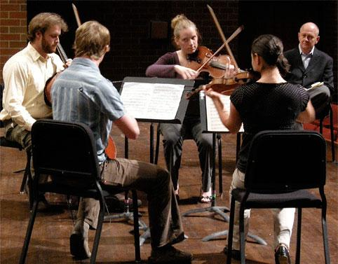 Guest artist William Preucil, concertmaster of the Cleveland Orchestra, coaching a UNC string quartet