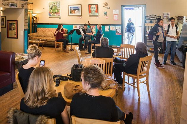 A chamber woodwind trio plays at a local coffee shop during the inaugural UNC Day of Music.