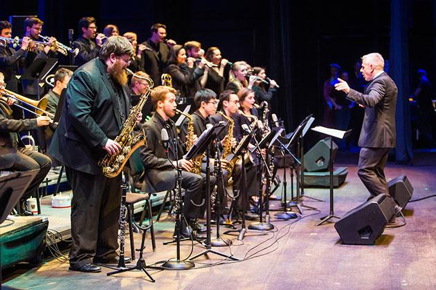 The award-winning Lab I band performs alongside Vocal Jazz members at the UNC Arts Gala in 2017.